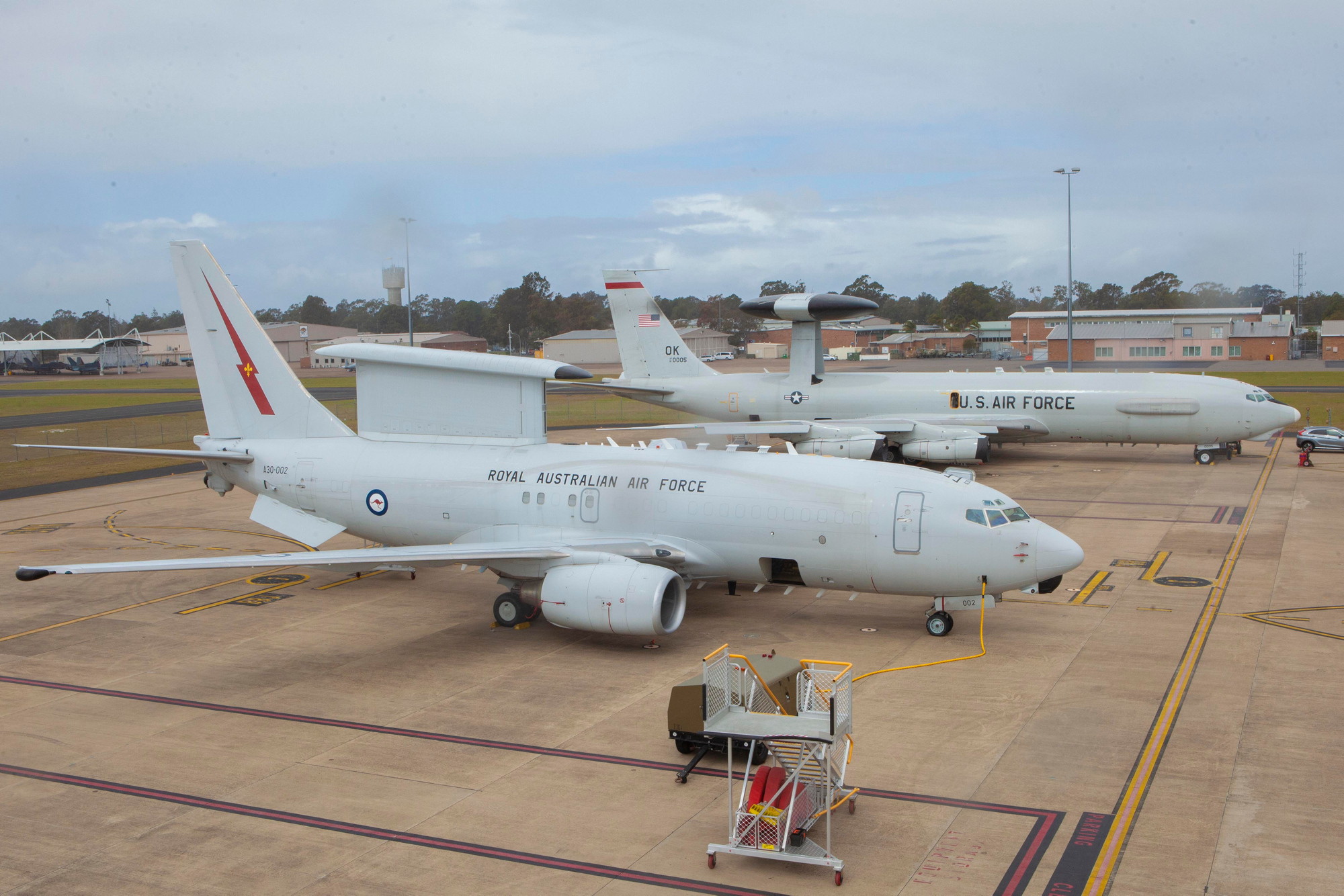 A RAAF E-7A Wedgetail and USAF E-3 Sentry sit side by side at RAAF Williamtown.