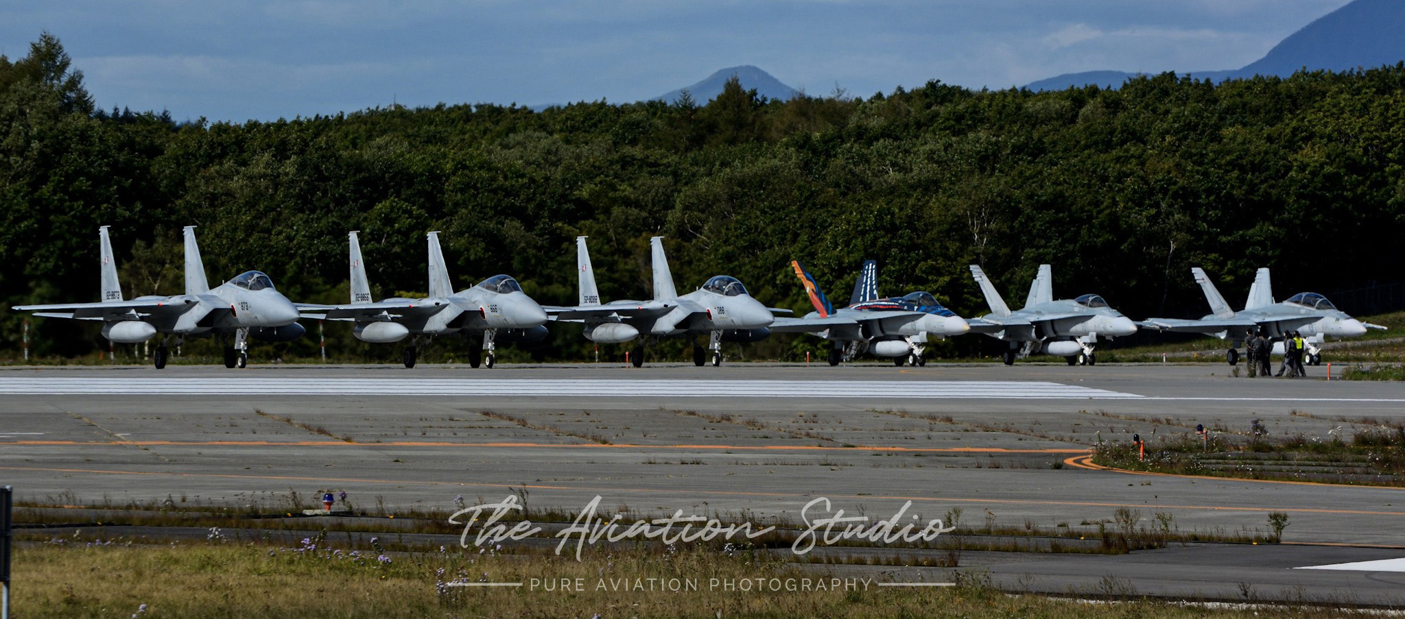 JASDF F-15J/DJ and RAAF F/A-18A/B prior to departure at Chitose Air Base