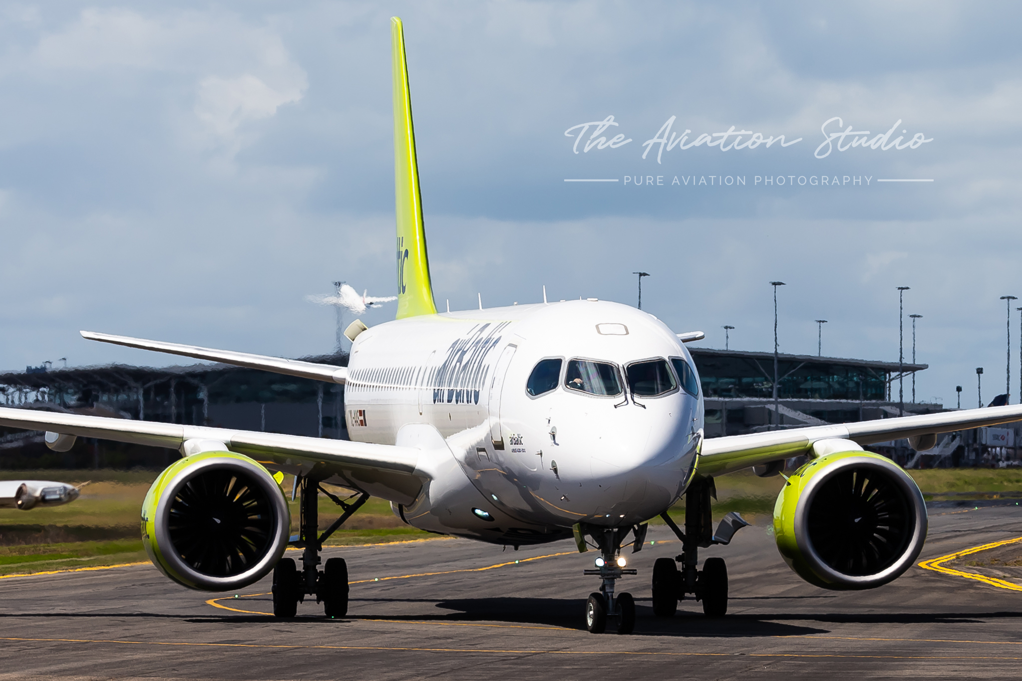 Air Baltic Airbus A220 taxiing at Brisbane Airport