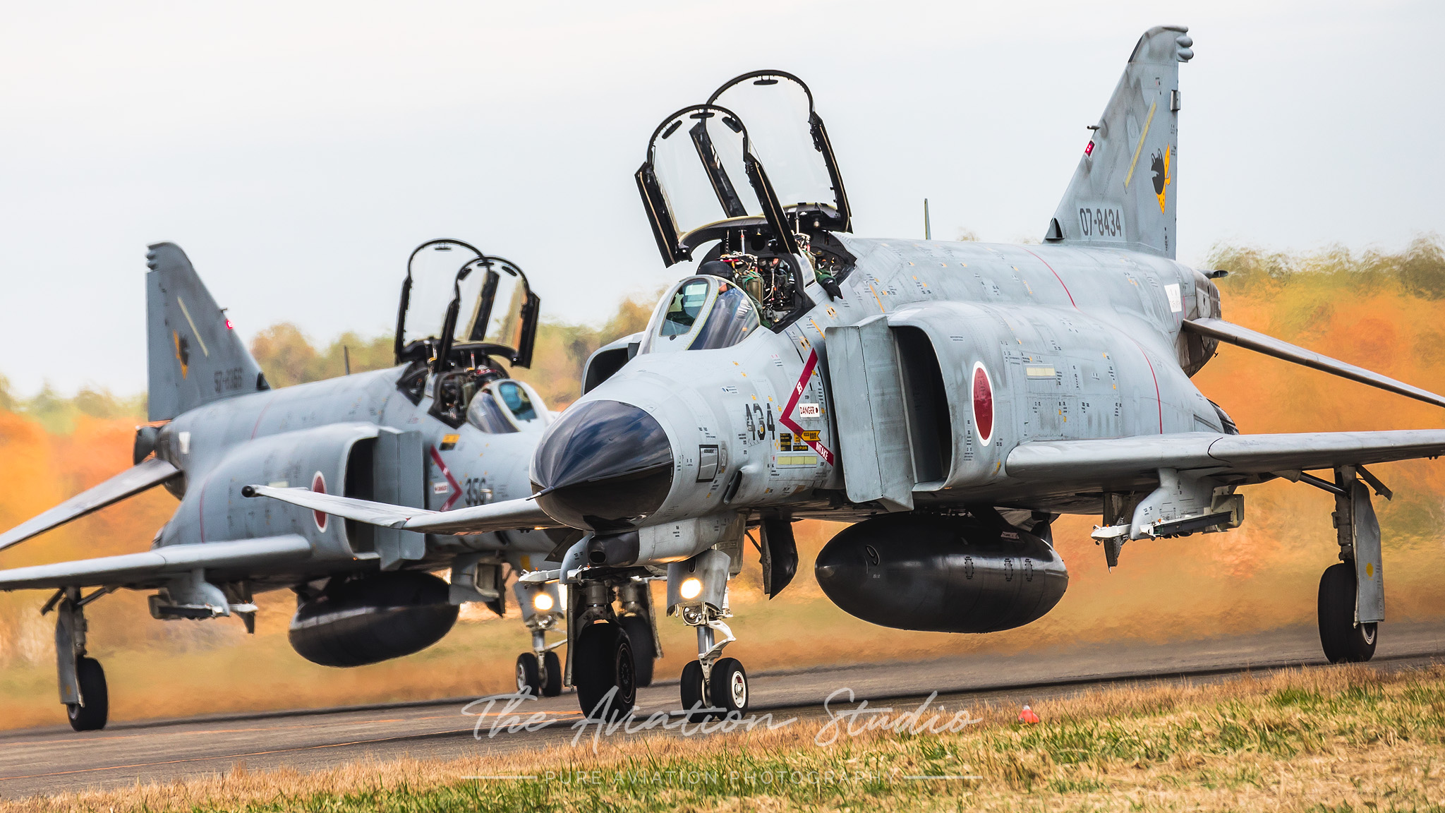 Two JASDF F-4EJ Kai's taxiing back to the display area