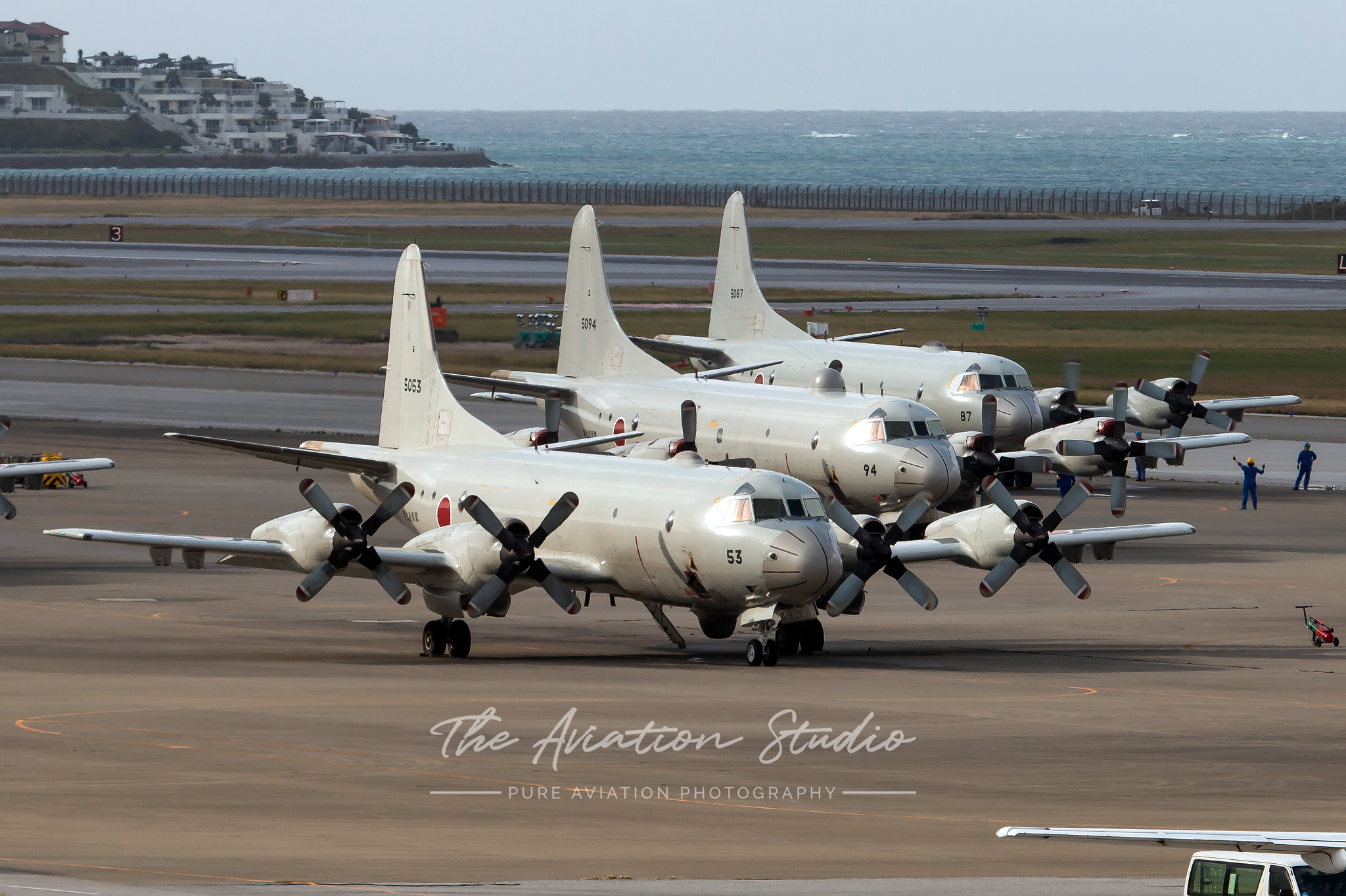 A trio of Lockheed P-3 Orions sitting at Naha Air Base (Image: Brock Little)