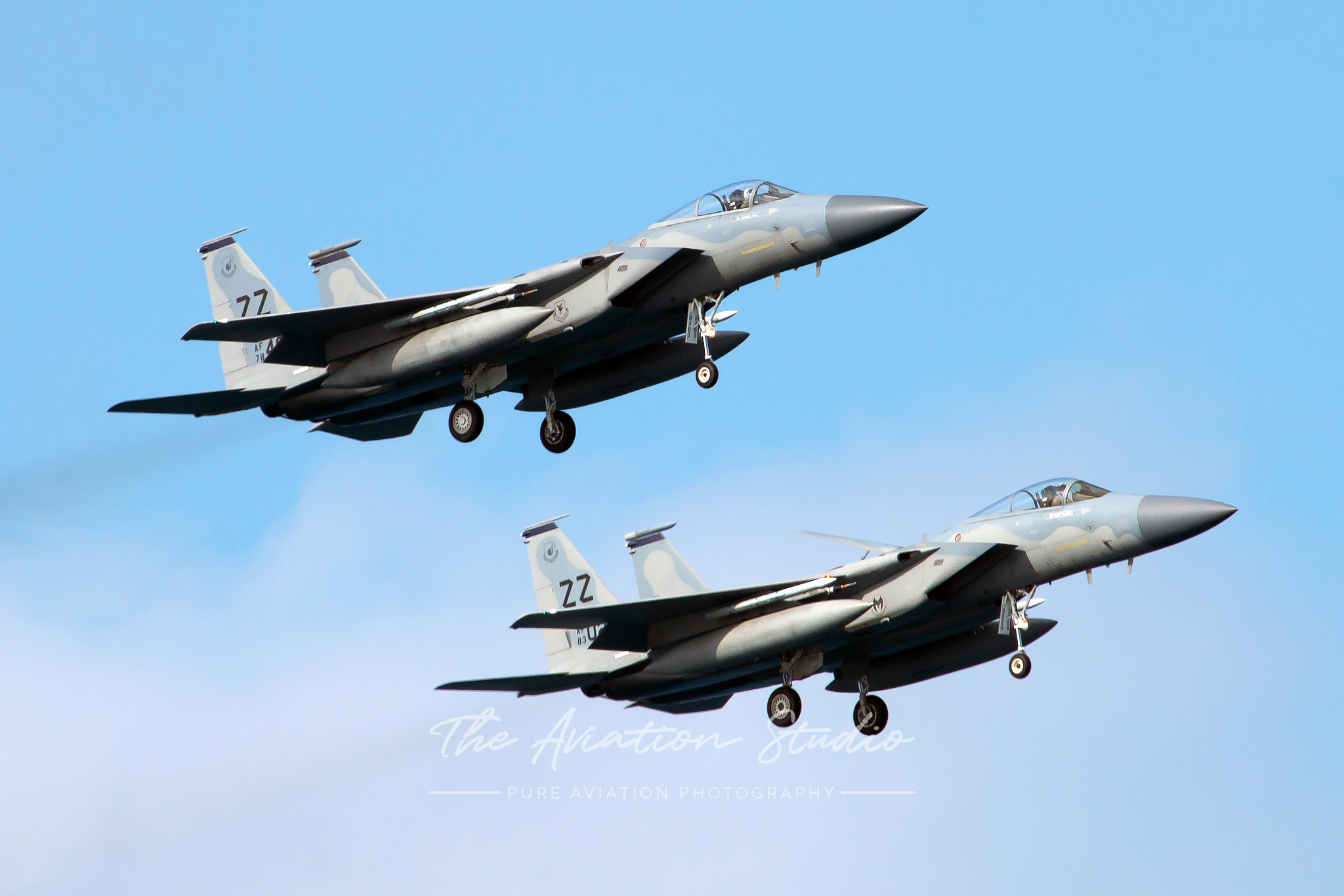 McDonnell Douglas F-15C Eagles 78-0483 and 83-0039 conducting a missed approach in close formation at Kadena (Image: Brock Little)