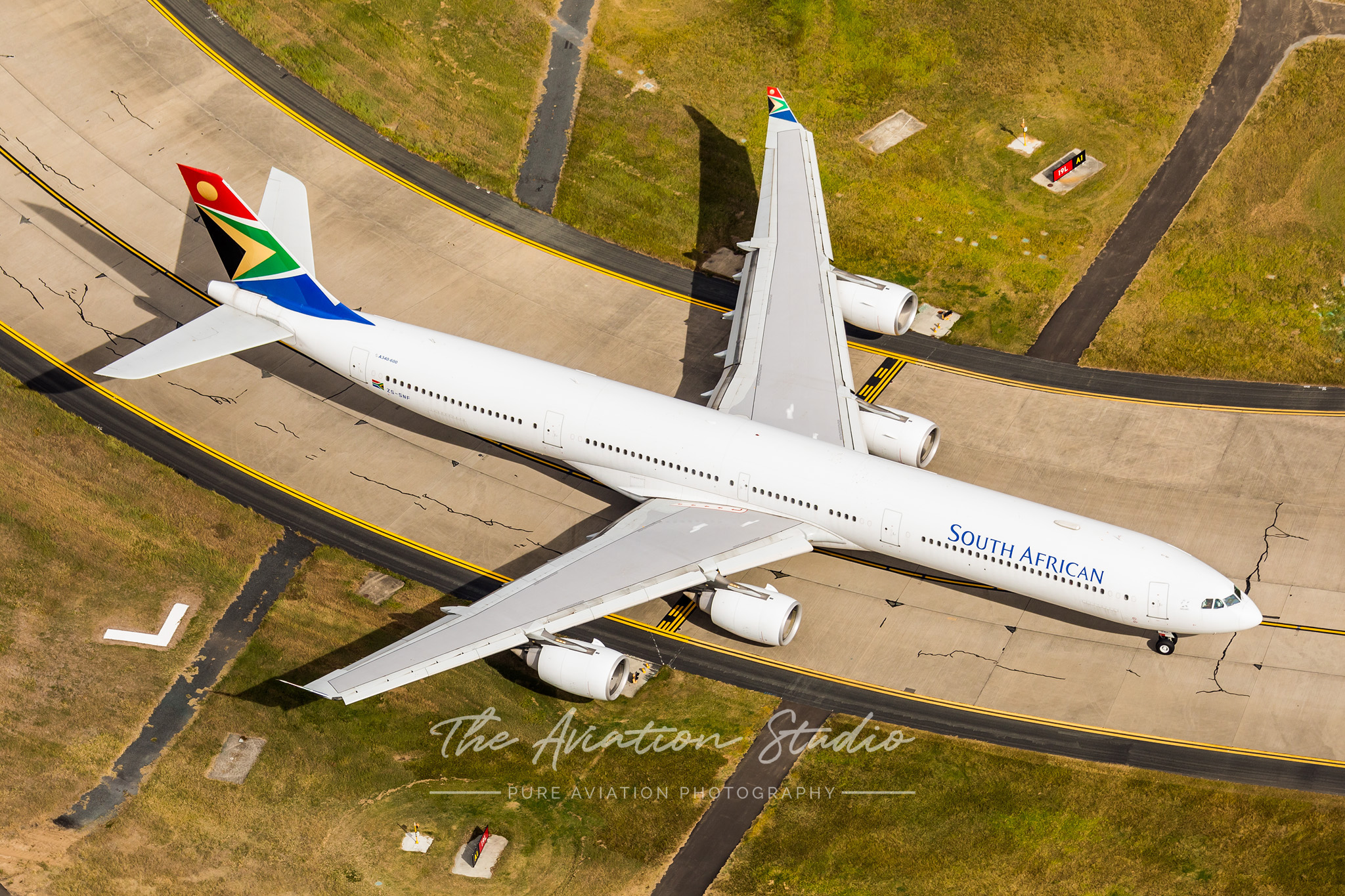 South African Airbus A340-600 ZS-SNF arrives at Brisbane Airport (Image: Emil Cooper)