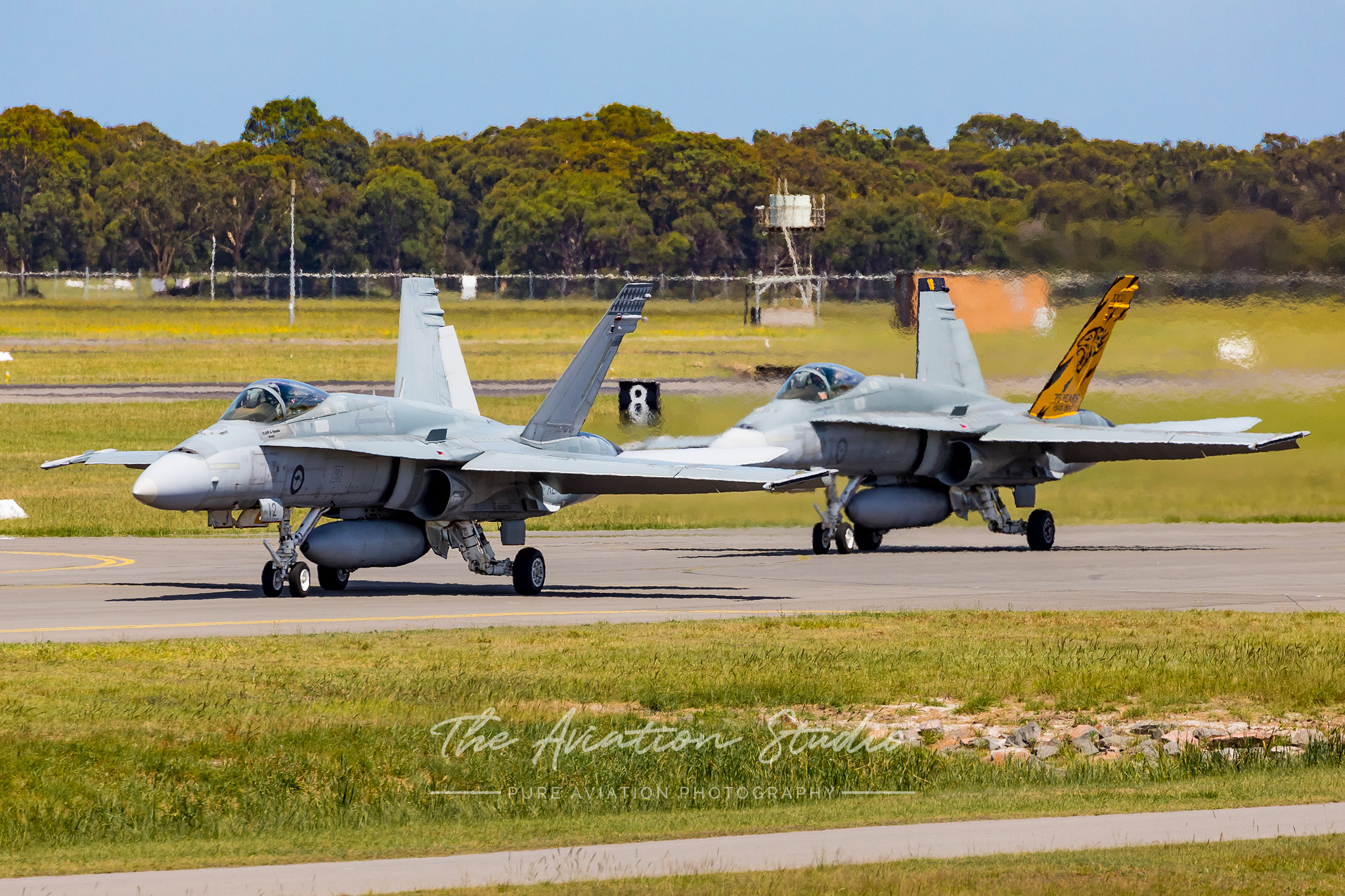 Two Classic Hornets taxiing out to RWY30 for a formation departure (Image: Emil Cooper)