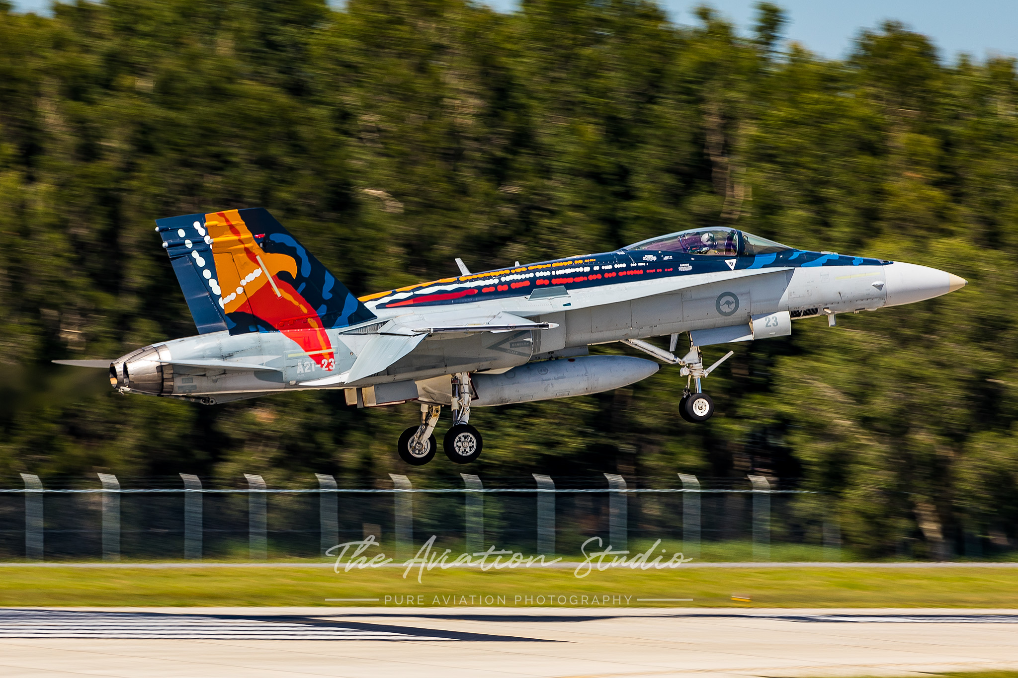 RAAF F/A-18A A21-23 moments from touching down for the final time at RAAF Base Williamtown (Image: Emil Cooper)