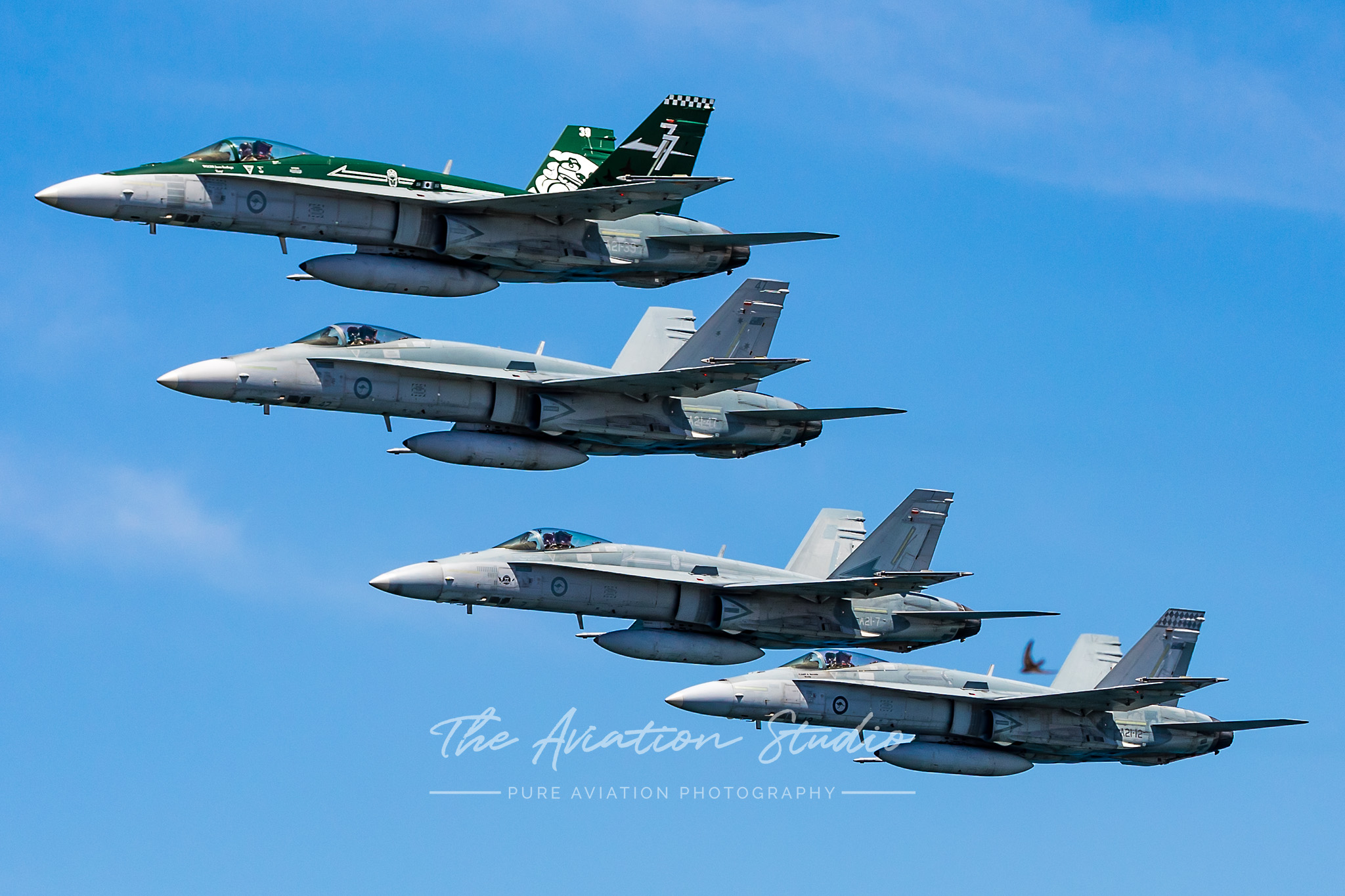 Four-ship flying a tight echelon on their run-in at Nobbys Beach (Image: Emil Cooper)