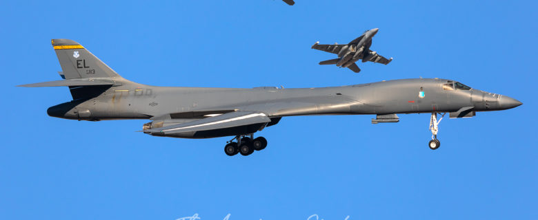 United States Air Force B-1B from Ellsworth Air Force Base turns base while Navy E/A-16G's join the overhead during Red Flag 20-1